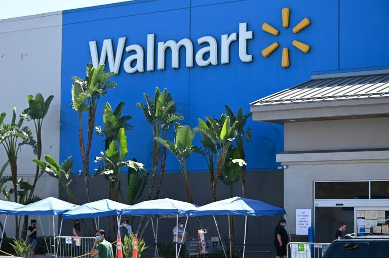 Walmart profits boosted by e-commerce, US stimulus payments