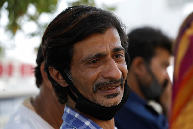 Shahid Ahmed, 45, mourns the death of his mother Irshad Begum, 72, who was killed in a plane crash, in Karachi