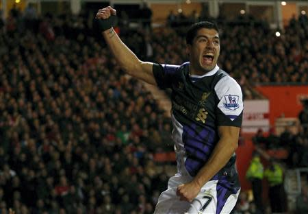 Luis Suarez of Liverpool celebrates team mate Raheem Stirling's goal against Southampton during their English Premier League soccer match at St Mary's Stadium in Southampton March 1, 2014. REUTERS/Andrew Winning