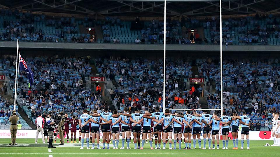 Fans and players, pictured here during a minute of silence at State of Origin.