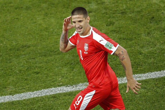 Serbia's Aleksandar Mitrovic celebrates after scoring the opening goal during the group E match between Switzerland and Serbia at the 2018 soccer World Cup in the Kaliningrad Stadium in Kaliningrad, Russia, Friday, June 22, 2018. (AP Photo/Antonio Calanni)