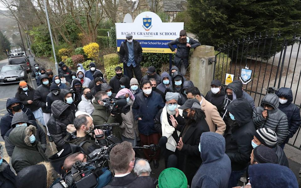 Protesters give a statement to members of the media - Danny Lawson/PA