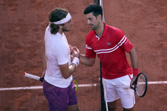 Serbia's Novak Djokovic , right, greets Stefanos Tsitsipas of Greece after their final match of the French Open tennis tournament at the Roland Garros stadium Sunday, June 13, 2021 in Paris. Djokovic 6-7, 2-6, 6-3, 6-2, 6-4.(AP Photo/Christophe Ena)