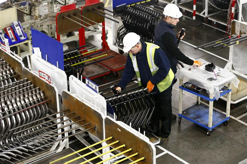 File photo of workers inspecting components on the fuel inlet production facility in Foston
