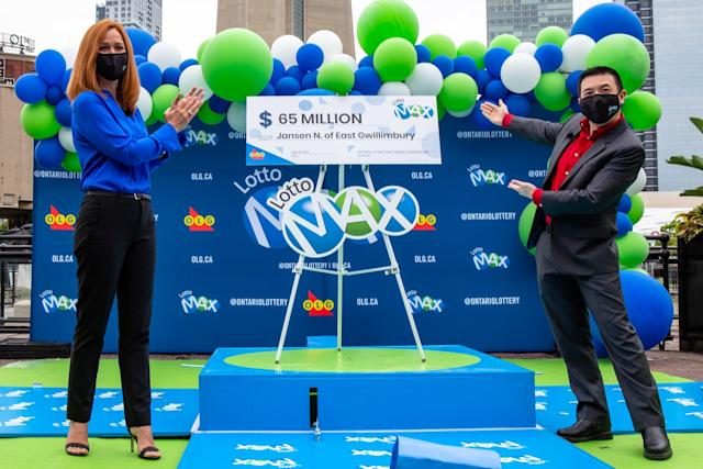 $65 million Lotto Max winner Jansen Ng of East Gwillimbury with Kim Clark, OLG's Vice President of Lottery and Customer Success (OLG)