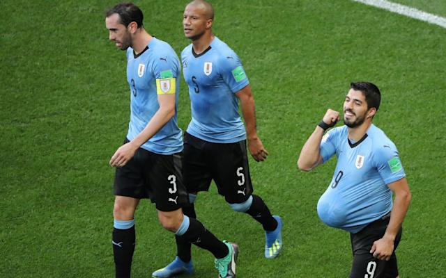 Luis Suarez scored the only goal of the game as Uruguay progressed to the knockout stages of the 2018 World Cup at Saudi Arabia's expense. The Barcelona forward prodded home midway through the first half after he had been left unmarked at the back post at a corner. The win takes his side's tally to six points from two games, but this was a second unconvincing display in succession against clearly inferior opposition. Near-30 degree heat in Rostov-on-Don meant the game's early pace could not be maintained, and the players visibly tired as the match wore on. However, against a Saudi Arabia side that had been beaten 5-0 by Russia in the tournament's opening match, Uruguay were expected to win comfortably, but they were extremely underwhelming in victory. Cristiano Ronaldo saves lucky Portugal to send Morocco out Iran vs Spain: team news and live build-up 6:12PM Still, at least the match had a hero It was that nice Luis Suarez. The perfect way for @LuisSuarez9 to celebrate his 100th appearance for @Uruguay! #URUKSApic.twitter.com/gLcuS66bd3— FIFA World Cup �� (@FIFAWorldCup) June 20, 2018 I think w'll just move on from this game, you know? Cheers for following. Head over to Iran vs Spain: team news and live build-up if you like. Cheers! 6:10PM This is more like it Midfield meandering. Uruguay vs Saudi Arabia 6:10PM This gives a false impression I think. Uruguay didn't really attack much. Uruguay vs Saudi Arabia shots on goal 6:09PM Golden Boot race? 6:04PM Where does that leave the group Uruguay and Russia will play for top spot on Group A in the final group game #WorldCuphttps://t.co/ltf1X6YJx2pic.twitter.com/kJubcjhD6f— Telegraph Football (@TeleFootball) June 20, 2018 5:52PM Full time: Uruguay 1 Saudi 0 Uruguay are through to the next round, the Saudis are out. Can't say I am especially sorry to see the back of the Saudi Arabian side, very limited. Uruguay surely can do better than that, a grinding performance, set piece goal and to be honest I think we should all just move on as quickly as possible! 5:50PM 90+ mins: Uruguay 1 Saudi 0 These folks have enjoyed their afternoon Credit: Tass via Getty Just four minutes added. 5:47PM 89 mins: Uruguay 1 Saudi 0 Corner for KSA. Decent ball, it's the big sub Kanno.... gets up well... but cannot get anything on the header from that range, maybe 15 yards from goal. 5:47PM Exceptional stuff #WorldCup: @BurgerKing apologizes for ad offering free whoppers to Russian women who get pregnant by tournament stars: https://t.co/By283QyNzX— AP Sports (@AP_Sports) June 20, 2018 5:45PM 85 mins: Uruguay 1 Saudi 0 Cavani nearly slams down the lid. Bursts down the centre, getting the better of the defenders, and is about to apply the finish as the keeper comes out, but just get in a tangle. Nahitan Nandez, known as Baby Rooney, is on for Carlos Sanchez. 5:42PM 80 mins Osama Hawsawi posing with some swans #KSApic.twitter.com/pTK1wp5Jy3— Footballers with animals (@ftbllrswanimals) June 14, 2018 5:38PM 79 mins: Uruguay 1 Saudi Arabia 0 Lucas Torreira shoots from distance, Cavani sticks out a leg, could have gone anywhere, this one. And in fact nearly goes in the KSA net! Keeper wrongfooted 5:33PM 74 mins KSA are wheeling on the big man, it is is Kanno. Bahebri is the man to make way. 5:32PM 73 mins So about 20 minutes left of a disappointing game, but there's no reason why Saudi Arabia cannot pinch a point here. 5:31PM I for one am shocked Vicki Sparks became first woman to commentate on a World Cup game for UK TV when calling Portgual/Morocco earlier on BBC. This was John Terry's reaction on Instagram. Charmer. pic.twitter.com/Pd2TmXa7Jm— Kieran Cunningham (@KCsixtyseven) June 20, 2018 5:28PM Suarez: quality player Luis Suarez - the first player to score at three different editions of the #WorldCup for @Uruguay! pic.twitter.com/B2xfSuZd47— FIFA World Cup �� (@FIFAWorldCup) June 20, 2018 Martin Caceres heads a corner over, beating Al-Dawsari in the air. 5:27PM Important day History maker! Well done @vksparks who this afternoon became the FIRST EVER woman to commentate live on a #WorldCup game for British TV by taking to the mic for @BBC for #PortugalvMorocco ������������#WomeninFootballpic.twitter.com/fwHlA8ceah— Women in Football (@WomeninFootball) June 20, 2018 5:26PM 66 mins: Good ball in from the Saudis but no effort on target. Al Dawsari fouls Sanchez. Ball in from URG now, and headed over. First poor game of the World Cup? 5:24PM 64 mins The player marking Suarez keeps kicking him, and frankly why wouldn't you? Saudis break, Gimenez hauls down Al-Harbi. 5:23PM Unclear whether this is a photoshoot or just the player on his day off, but... Cristian Rodriguez patriotically riding a horse #URUpic.twitter.com/1e0R39YJ9S— Footballers with animals (@ftbllrswanimals) June 20, 2018 5:20PM 61 mins: Uruguay 1 Saudi Arabia 0 Lovely ball from Cavani, moment of proper quality. He waits, picks his moment, and puts it on the head of Sanchez... who should have done better with the free header. 5:16PM 57 mins: Uruguay 1 Saudi Arabia 0 Laxalt and Torreira are coming on for Uruguay. Vecino and Rodriguez off. 5:14PM 53 mins: Uruguay 1 Saudi Arabia 0 Mohammad Al-Breik, known to all the lads in the changing room as Ready Breik, heads back across goal but there's not a lot in the way of pressure on the ball/keeper. 5:09PM 50 mins: Uruguay 1 Saudi Arabia 0 Suarez cracks the ball at goal but it is blocked. 5:08PM 49 mins Freekick for Uruguay. Central, about 30 yards out. Saudis think they have been hard done by. And I agree: Carlos Sanchez went down cheaply after the challenge from Salma Alfaraj. 5:04PM 46 mins: Uruguay 1 Saudi Arabia 0 Decent start to the half again from the Saudis. 5:03PM Players are out for the second half Let's hope we see a bit more quality from this pair. Credit: BBC 4:52PM Ton up Suarez won his 100th cap, and opened the scoring Credit: AP 4:50PM Here's Al-Flappy Bird in the Saudi goal, bit of a howler. Saudi goalie Credit: BBC 4:48PM Half time: Uruguay 1 Saudi Arabia 0 Yes, not a classic, but Uruguay just about deserve it, and have one foot in the next round. Saudis given a decent account of themselves. 4:47PM 44 mins: Uruguay 1 Saudi Arabia 0 This has not been a great game. URG are sitting deep, KSA are... sitting deep. Uruguay vs Saudi Arabia shots on goal 4:41PM 40 mins: Uruguay 1 Saudi Arabia 0 Taiseer Aljassam is coming off. Shame. He went on a good run, stretched as he tried to keep control of the ball, and looks to have done a hamstring. Al-Moghawi on. Miss: Uruguay 1 - 0 Saudi Arabia (Salem Al Dawsari, 38 min) 4:37PM URG like to get out wide and Average touch positions (25 min) aim to cross for their front two. 4:34PM 30 mins: Uruguay 1 Saudi Arabia 0 URG needed to buck their ideas up, because they are sloppy and this Saudi side, ordinary though it may be, should be level. Simple ball comes across, Caceres loses his man, and Hatan Bahbri has spurned a simple chance from close range 4:26PM 25 mins: Uruguay 1 Saudi Arabia 0 Decent run and hit from KSA striker Hatan Bahbri, tipped over, Saudis have a corner. 4:24PM GOAL! Suarez! Uruguay 1 Saudi Arabia 0 Shocker from the keeper, shocker from the defence as well come to that. Corner comes over, keeper comes out flapping, and Suarez taps it in. But who was marking Suarez? Just not acceptable. Looks like Taisir Al Jassam was the man who let him loose. That's the Suarez we know and admire. Marks his 100th game for Uruguay with a customary poacher's goal. ����— Gary Lineker (@GaryLineker) June 20, 2018 4:22PM 22 mins: Uruguay 0 Saudi Arabia 0 That's good play from Uruguay, they are very strong down the flanks, and with their two dangerous strikers they are going to cause some problems. 4:21PM 20mins: Uruguay 0 Saudi Arabia 0 Al-Muwallad finds himself in space in the area, and with time... no. shoots well over. 4:19PM 18 mins: Uruguay 0 Saudi Arabia 0 Lofted forward for Rodriguez, he tries il spectaculari. No. 4:15PM 14 mins: Uruguay 0 Saudi Arabia 0 Ooh, danger. URG get down the flank, the tireless Suarez pops up and, gathering the ball right on the goalline, tries to lash it across. Hits the defender and goes behind. 4:13PM 11 mins: Uruguay 0 Saudi Arabia 0 Good atmosphere so far but not what you would call a classic. Martin Caceres cuts it back for Edinson Cavani, whose first-time effort is over. Miss: Uruguay 0 - 0 Saudi Arabia (Edinson Cavani, 13 min) 4:08PM 7 mins They are taking their time. Eventually it is whacked at the wall by Mohammed Alburay. Behind for a corner. Poor delivery from that as they take it short and then donk it in pointlessly. 4:07PM 6 mins Not a bad start from KSA. They're getting a few forward. They've got a freekick, central, about 30 yards out. 4:03PM 3 mins: Uruguay 0 Saudi Arabia 0 That's a handy ball forward from SA, but the formidable Godin has read it well. Suarez has unleashed one: Cristian Rodriguez knocked it down for him, and Saudi Arabia defender Ali Albulayhi did well to get in the way. Attempt Saved: Uruguay 0 - 0 Saudi Arabia (Luis Suárez, 2 min) 4:01PM 1 mins: Uruguay 0 Saudi Arabia 0 The South Americans in their pale blue, the Saudis are in white. Uruguay enjoying a few early touches at the back, allowed to stroke it about. No press from the Saudis. 4:00PM Ready to play football Credit: BBC 3:57PM Saudi one No messing. Sounds like people hailing a taxi. All over very quickly. 3:57PM Uruguay anthem is a good un There's a long and hymn like intro bit, sounds somewhat like God Save The Queen, and then a shouted call and response section. 3:55PM Rostov Arena World Cup 2018 stadium: Rostov Arena 3:54PM The players are out on the pitch It's mad hot there. 36 degrees I think they just said on the telly. Edinson Cavani celebrates with Rodrigo Bentancur after Uruguay broke the deadlock late on against Egypt Credit: GETTY IMAGES 3:46PM Great bunch of lads #URUKSA | @ECavaniOfficial durante el calentamiento de @Uruguay en el Arena Rostov.#ElEquipoQueNosUne#Rusia2018pic.twitter.com/1zQT4KfjPT— Selección Uruguaya (@Uruguay) June 20, 2018 3:44PM Ronaldo on course for that boot 3:43PM There's the Biter Credit: BBC 3:40PM Dat ink Arsenal-bound Lucas Torreira is on the bench for #URU - what can Arsenal fans expect from him and what will be bring? #AFChttps://t.co/8HfcUJgGNTpic.twitter.com/tfDkzVIWB2— Telegraph Football (@TeleFootball) June 20, 2018 3:39PM Lot of Als Uruguay: Muslera, Varela, Gimenez, Godin, Caceres, Sanchez, Vecino, Bentancur, Rodriguez, Suarez, Cavani. Subs: Campana, Nandez, De Arrascaeta, Stuani, Gaston Silva, Torreira, Maxi Pereira, Laxalt, Gomez, Coates, Urreta, Martin Silva. Saudi Arabia: Al-Owais, Al-Breik, Osama Hawsawi, Al Bulaihi, Al-Shahrani, Bahbir, Al-Faraj, Otayf, Al-Jassam, Al Dawsari, Al-Muwallad. Subs: Al-Muaiouf, Al-Harbi, Omar Hawsawi, Al-Shehri, Al-Sahlawi, Al-Khaibri, Kanno, Al-Khaibari, Al-Moqahwi, Asiri, Motaz Hawsawi, Al-Mosailem. Referee: Clement Turpin (France) Ah it is referee Dick Turpin! Always good to see him getting a game. 3:36PM Horrible to see Just hope he's okay. Anyway, back to the matter at hand. 3:30PM Shocking assault on defenceless Pepe Please keep Pepe in your prayers after this assault from Benatia �� #PORMAR#WorldCuppic.twitter.com/UbYwFtEQld— World Cup Goals (@FIFAWCGoals) June 20, 2018 3:29PM UPSETTING CONTENT WARNING Please look away now if you are easily distressed. 3:23PM Ranks as highly as any in Rome Very much enjoyed @jj_bull rankings of every World Cup team after one game. https://t.co/fD9txR5iJD— Thom Gibbs (@thomgibbs) June 20, 2018 3:21PM Expecting Saudis to go with one up front, that will be Fahad. 3:05PM And their opponents Now, on to Match 2... Here are the teams for #URUKSA ��@Uruguay // @SaudiNT_ENpic.twitter.com/Jp3zCm61Ah— FIFA World Cup �� (@FIFAWorldCup) June 20, 2018 2:53PM Here is the Uruguay team #URUKSA | #Rusia2018 | Formación de @Uruguay para enfrentar a Arabia Saudita por la fecha 2 del grupo A. #ElEquipoQueNosUnepic.twitter.com/axn8NGJ8lu— Selección Uruguaya (@Uruguay) June 20, 2018 2:49PM This was super cute by the way This is how school kids in Uruguay celebrated their team's last minute goal in their first match at the #WorldCup. pic.twitter.com/Zw9HRLMuSP— Al Jazeera English (@AJEnglish) June 20, 2018 2:43PM We will have the teams ASAP And then kick off is at 4pm UK time. 2:40PM Of a betting persuasion? If so, here is our handy guide to what you might fancy a punt on Betting guide: predictions and tips for Uruguay v Saudi Arabia > Our betting boffins reckon that Suarez and his mates might well stick plenty past the Saudis and have suggested a wager accordingly... 2:37PM Here is the Group A table 2:16PM Is Luis Suarez still a bit fat? He looked chunky in the first game, I thought, although that might have been the all-white kit. Very unforgiving, is all-white, as I found to my own personal cost after an ill-advised foray into the world of the Man From Delmonte linen suit a few summers back. Anyway, he was off his game in the first match and Uruguay as a whole were so-so against Egypt, needing a late winner from Jose Gimenez to win by the single goal. Talking of the first game, though, Saudi Arabia were pure mince. They are the only team I have seen so far who had nothing going for them: lumpen centre backs, no pace, no invention, no clue really. Time will tell whether that 5-0 by Russia is evidence of Ruskie excellence or Saudi hopelessness but either way, I would be absolutely astonished if they get through the group. Uruguay can do themselves a massive favour by winning today and rendering their clash with Russia a formality / decider as to who tops group A. Uruguay have an experienced, quality defence with the likes of Diego Godin, they have Edinson Cavani and Suarez up front, that is a Champions League semis-level strike force. Suarez can win his 100th cap in this match (team news will be with us shortly). He'll be the sixth Uruguayan to do so. Carlos Sanchez (not to be confused with the Colombian Carlos Sanchez who was sent off yesteryday) may play right wing, Cristian Rodriguez left. To that point, Group A is paired with Group B for the last 16: so, assuming that goes to form, would you rather play Spain or Portugal? Portugal are currently leading Morocco 1-0 but that game looks far from settled. Why not check in with Ben Bloom's live blog while we wait? For those whose thoughts are only for England, here is all the reaction to their group opener. Tunisia 1 England 2 | Kane snatches winning World Cup start for Southgate's men