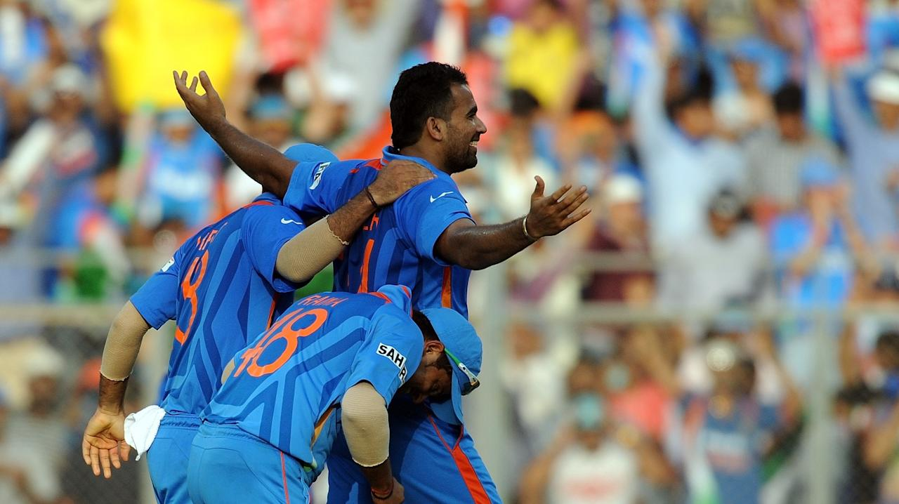 India bowler Zaheer Khan (R) celebrates the wicket of Sri Lanka batsman Chamara Kapugedera with teammates during the final of ICC Cricket World Cup 2011 match between India and Sri Lanka at The Wankhede Stadium in Mumbai on April 2, 2011. Sri Lanka won the toss and elected to bat first. AFP PHOTO / Prakash SINGH (Photo credit should read PRAKASH SINGH/AFP/Getty Images)