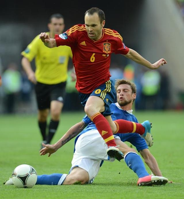TOPSHOTS Spanish midfielder Andres Iniesta (top) vies with Italian midfielder Claudio Marchisio during the Euro 2012 championships football match Spain vs Italy on June 10, 2012 at the Gdansk Arena. AFP PHOTO / CHRISTOF STACHECHRISTOF STACHE/AFP/GettyImages