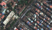 """This satellite image provided by Maxar Technologies shows a painting of letters that reads, """"FREE OUR LEADERS,"""" on a street in Yangon, Myanmar, Monday, Feb. 22, 2021. (Maxar Technologies via AP)"""