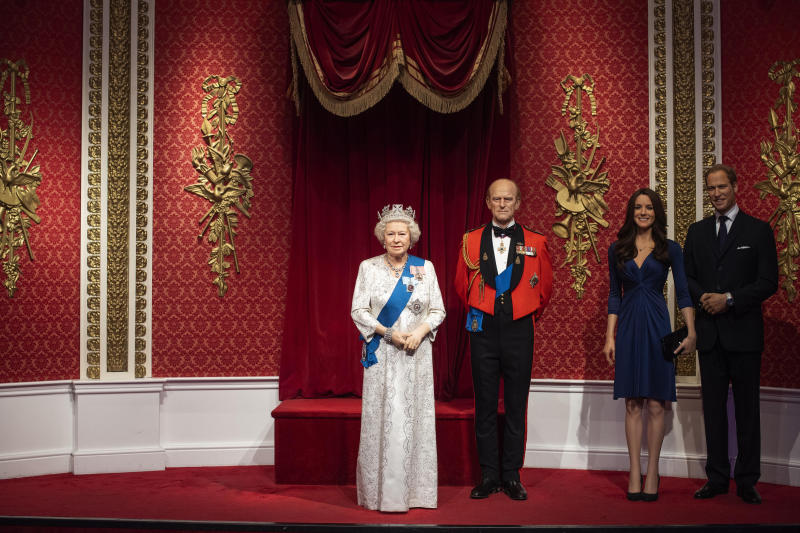 The empty space after the figures of Britain's Prince Harry and Meghan, Duchess of Sussex, were removed next to Queen Elizabeth II, Prince Philip and Prince William and Kate, Duchess of Cambridge, at Madame Tussauds in London, Thursday Jan. 9, 2020. Madame Tussauds moved its figures of Prince Harry and Meghan, Duchess of Sussex from its Royal Family set to elsewhere in the attraction. (Victoria Jones/PA via AP)