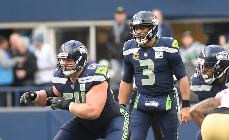 How do the Dolphins hope to contain Seahawks QB Russell Wilson?