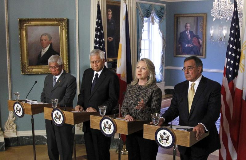 FILE - In this April 30, 2012, file photo Secretary of State Hillary Rodham Clinton, Secretary of Defense Leon E. Panetta, right, Philippines' Secretary of National Defense Voltaire Gazmin, left, and Secretary of Foreign Affairs Albert del Rosario speak at a news conference at the Department of State in Washington. The U.S. increased military aid and resolved to help its ally on maritime security. The steps came as the Philippines is locked in a standoff with China over competing territorial claims in the South China Sea, and passions stokes on both sides. (AP Photo/Haraz N. Ghanbari, File)
