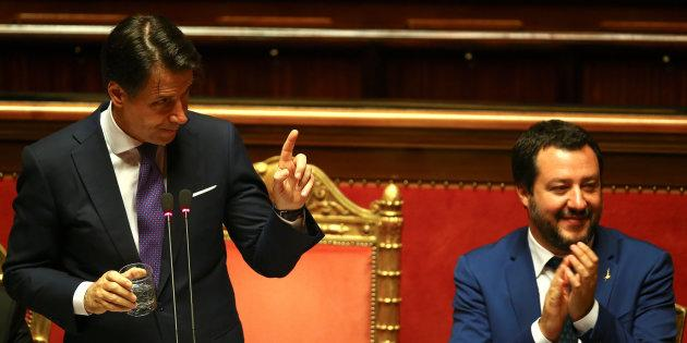 Newly appointed Italian Prime Minister Giuseppe Conte gestures next to Interior Minister Matteo Salvini during his first session at the Senate in Rome, Italy, June 5, 2018. REUTERS/Alessandro Bianchi