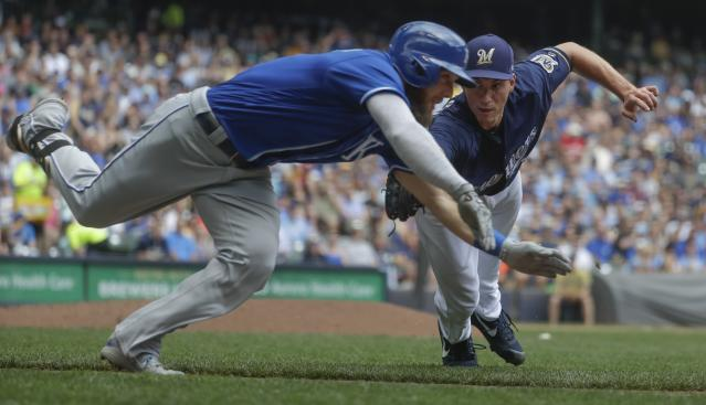 Milwaukee Brewers' Brent Suter tags out Kansas City Royals' Alex Gordon on an infield ground ball during the fifth inning of a baseball game Wednesday, June 27, 2018, in Milwaukee. (AP Photo/Morry Gash)