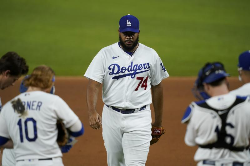 Los Angeles Dodgers relief pitcher Kenley Jansen (74) walks up to the mound to work against the San Diego Padres in Game 1 of a baseball National League Division Series Wednesday, Oct. 7, 2020, in Arlington, Texas. (AP Photo/Tony Gutierrez)