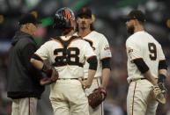 San Francisco Giants pitcher Jeff Samardzija, third from left, meets with pitching coach Curt Young, left, Buster Posey (28) and Brandon Belt (9) in the third inning of a baseball game against the Washington Nationals, Monday, Aug. 5, 2019, in San Francisco. (AP Photo/Ben Margot)