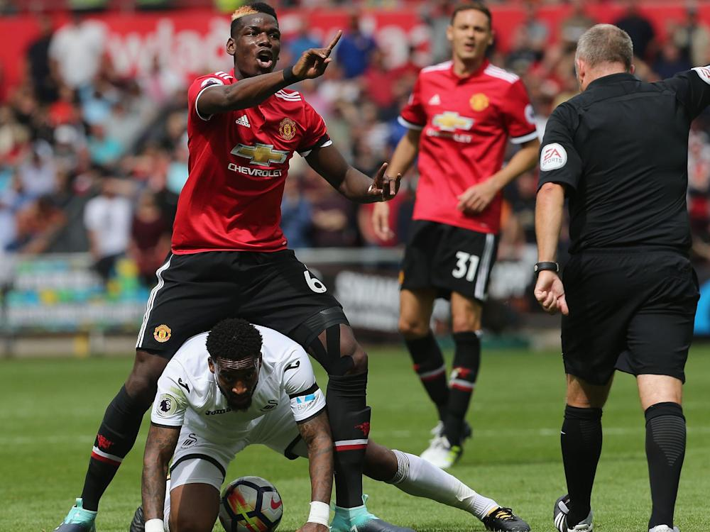 Paul Pogba appeals against receiving a booking after fouling Leroy Fer in Manchester United's win over Swansea: Getty