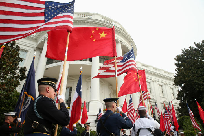 FILE - In this Sept. 25, 2015, file photo, a military honor guard await the arrival of President Barack Obama and Chinese President Xi Jinping for a state arrival ceremony on the South Lawn of the White House in Washington. (AP Photo/Andrew Harnik, File)