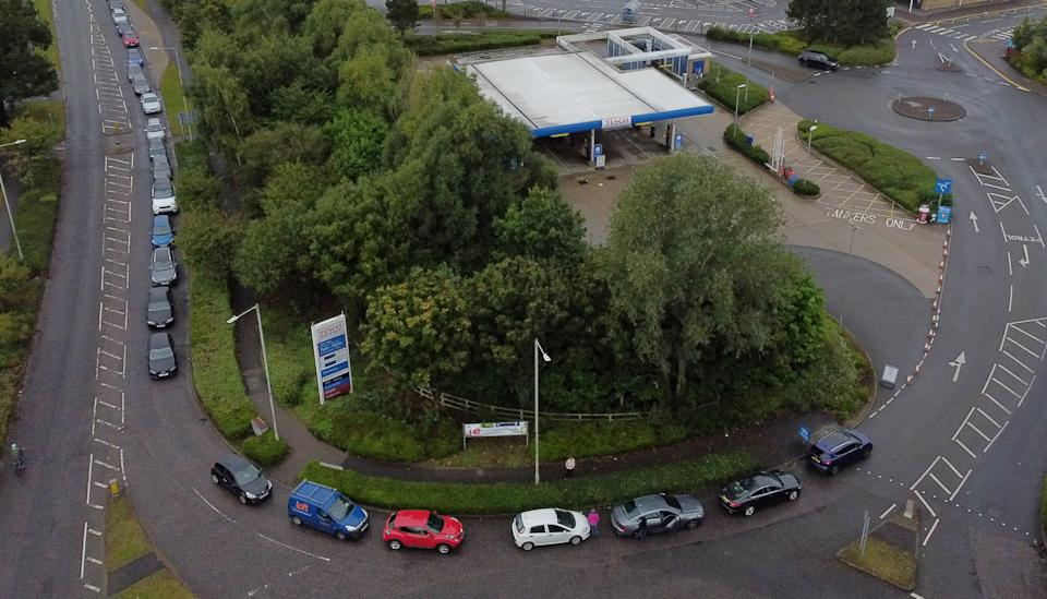 Motorists queue for a petrol station to open at a Tesco in Ashford, Kent. Picture date: Sunday October 3, 2021.