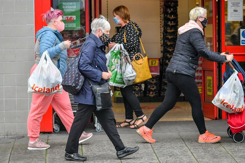 "Shoppers wear masks as they walk around the shops in Caerphilly centre as the county borough of Caerphilly in south Wales is under a local lockdown following a ""significant rise"" in coronavirus cases. People are not allowed to enter or leave the area without a reasonable excuse after restrictions came into force at 6pm Tuesday August 8."