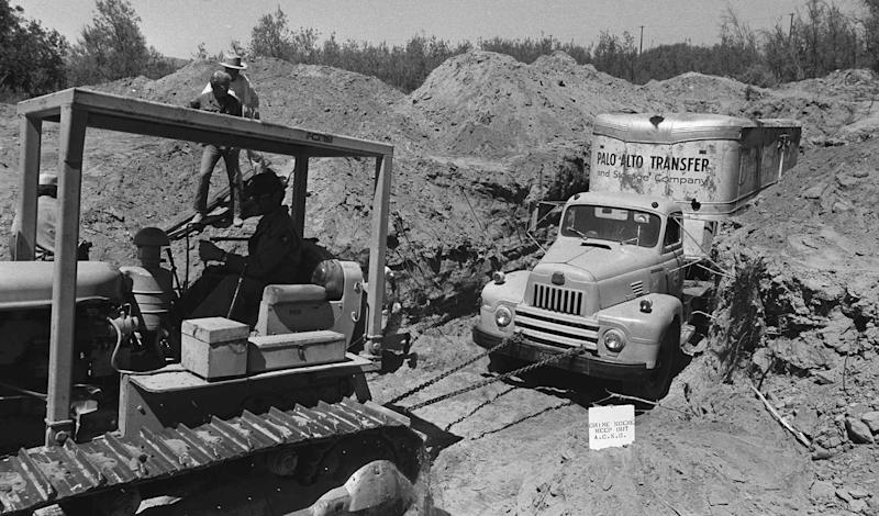 FILE - In this July 20, 1976 file photo, officials remove a truck buried at a rock quarry in Livermore, Calif., in which 26 Chowchilla school children and their bus driver, Ed Ray were held captive. Ray, the school bus driver hailed as a hero for helping 26 students escape after three men kidnapped the group and buried the entire bus underground in 1976 died on Thursday, May 17, 2012. He was 91. (AP Photo, File)