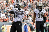New Orleans Saints running back Alvin Kamara (41) reacts after scoring a touchdown in the first half of an NFL football game against the Cincinnati Bengals, Sunday, Nov. 11, 2018, in Cincinnati. (AP Photo/Frank Victores)