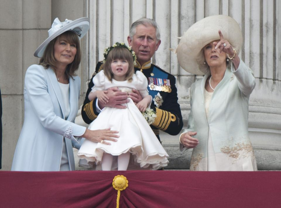 (Left-Right) Carole Middleton, Prince Charles, Holding Bridesmaid Eliza Lopes And The Duchess Of Cornwall, On The Balcony Of Buckingham Palace, London, Following The Wedding Of Prince William And Kate Middleton At Westminster Abbey. (Photo by Antony Jones/Julian Parker/Mark Cuthbert/UK Press via Getty Images)