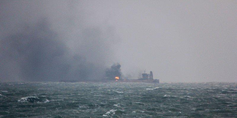 Smoke is seen from Panama-registered Sanchi tanker carrying Iranian oil that caught ablaze after it collided with a Chinese freight ship in the East China Sea. China's Ministry of Transport  via REUTERS