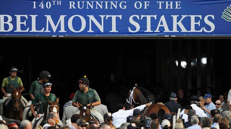 Big Brown led off the track with the Belmont Stakes banner