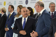 Turkish Foreign minister Mevlut Cavusoglu, center, attends the Crimean Platform Summit in Kyiv, Ukraine, Monday, Aug. 23, 2021. The Crimea Platform is a new international consultation and coordination format to strengthen an international response to the ongoing Russia's occupation of Crimea. (Ukrainian Presidential Press Office via AP)