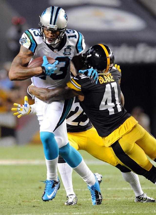 Carolina Panthers wide receiver Kelvin Benjamin (13) is hit by Pittsburgh Steelers defensive back Antwon Blake (41) in the second quarter of a NFL preseason football game on Thursday, Aug. 28, 2014 in Pittsburgh. (AP Photo/Don Wright)