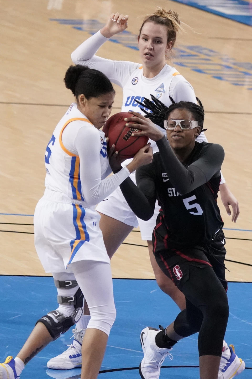 Stanford forward Francesca Belibi, right, works for a rebound against UCLA guard Camryn Brown during the first half of an NCAA college basketball game Monday, Dec. 21, 2020, in Los Angeles. (AP Photo/Marcio Jose Sanchez)