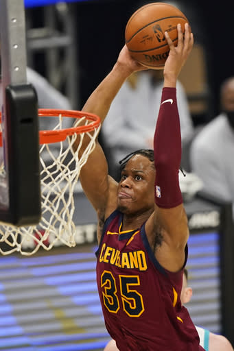 Cleveland Cavaliers' Isaac Okoro dunks against the Charlotte Hornets during the first half of an NBA basketball game Wednesday, Dec. 23, 2020, in Cleveland. (AP Photo/Tony Dejak)