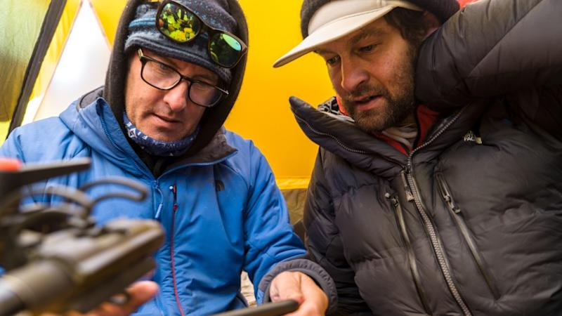 "Lost on Everest -- National Geographic TV Special, Mark Synnott and Renan Ozturk look at a GPS path for the drone during an expedition to find Sandy Irvine's remains on Mt. Everest. (National Geographic/Matt Irving) Mark Synnott, left, and Renan Ozturk in ""Lost on Everest"" on National Geographic."