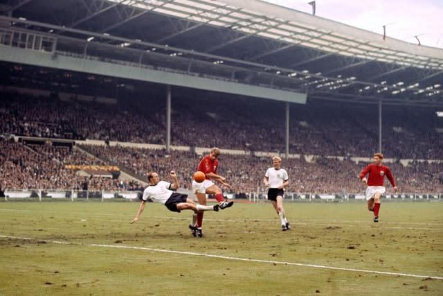 Ball, right, in action in the 1966 World Cup final (PA)