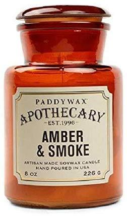 """<h3>Paddywax Amber & Smoke Candle</h3><br>We'll just leave you with this Amazon review: """"Close your eyes and imagine that you live in a cabin in the woods, surrounded by towering pine trees and creeping wildflowers. You live with your handsome, bearded husband who built the cabin with his own two hands. You go inside holding a basket of vegetables that you just picked from the garden, and a wave of warmth embraces you. You take in the scene: dried herbs hanging from ceiling, shelves and shelves of all your favorite books, and your husband sitting by the fireplace. He had been outside chopping firewood, and his strong muscles are glistening with sweat in the light. He looks up at you warmly as you enter, and you see a smear of soot on his cheek from building the fire. He sits in his favorite rocking chair smoking a pipe, and as he pulls you into his lap you watch the tobacco smoke drift lazily towards the ceiling. You take a deep breath, and it smells sweet, musky, and earthy. It smells like home.""""<br><br><strong>Paddywax</strong> Apothecary Collection Candle, Amber & Smoke, $, available at <a href=""""https://amzn.to/2MiuQTT"""" rel=""""nofollow noopener"""" target=""""_blank"""" data-ylk=""""slk:Amazon"""" class=""""link rapid-noclick-resp"""">Amazon</a>"""
