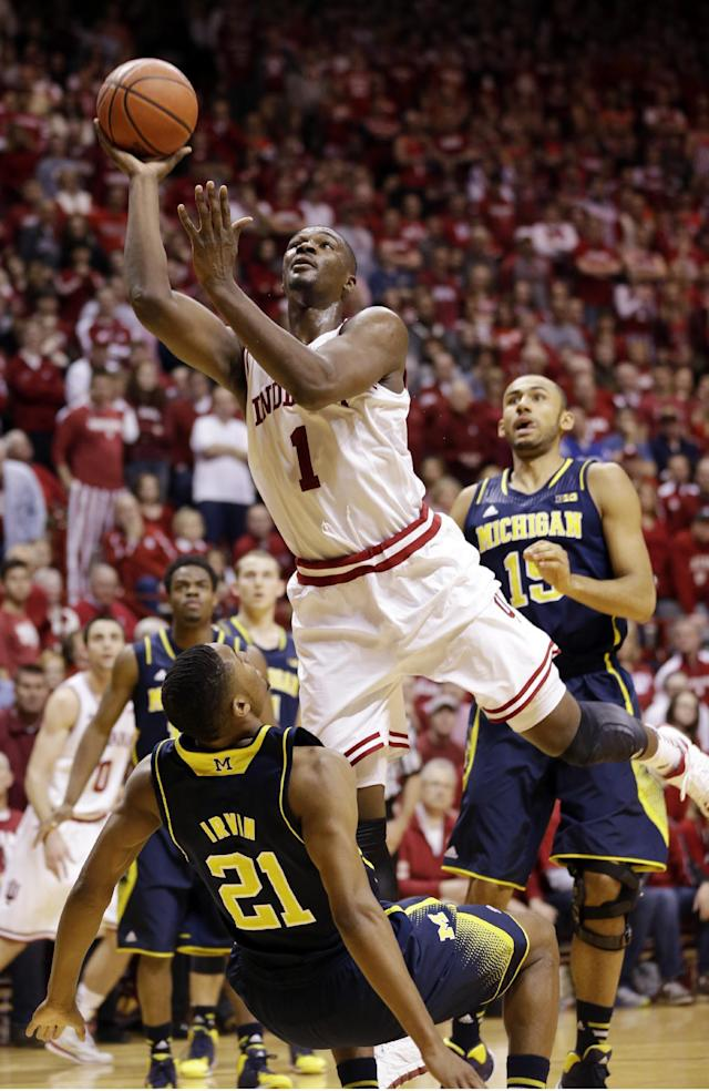 Indiana forward Noah Vonleh (1) charges into Michigan guard Zak Irvin in the second half of an NCAA college basketball game in Bloomington, Ind., Sunday, Feb. 2, 2014. Indiana defeated Michigan 63-52. (AP Photo/Michael Conroy)