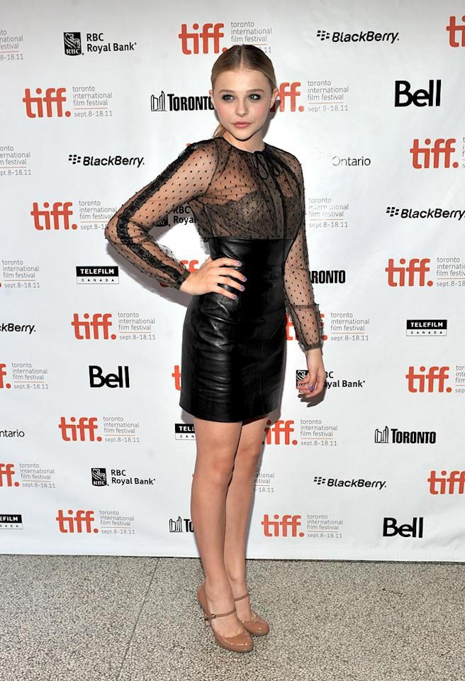 """Like Madonna, actress Chloe Moretz's look featured long sleeves and sheer paneling. What do you make of the pint-sized star's Valentino blouse and leather skirt? Hot or not? Sonia Recchia/<a href=""""http://www.gettyimages.com/"""" target=""""new"""">GettyImages.com</a> - September 10, 2011"""