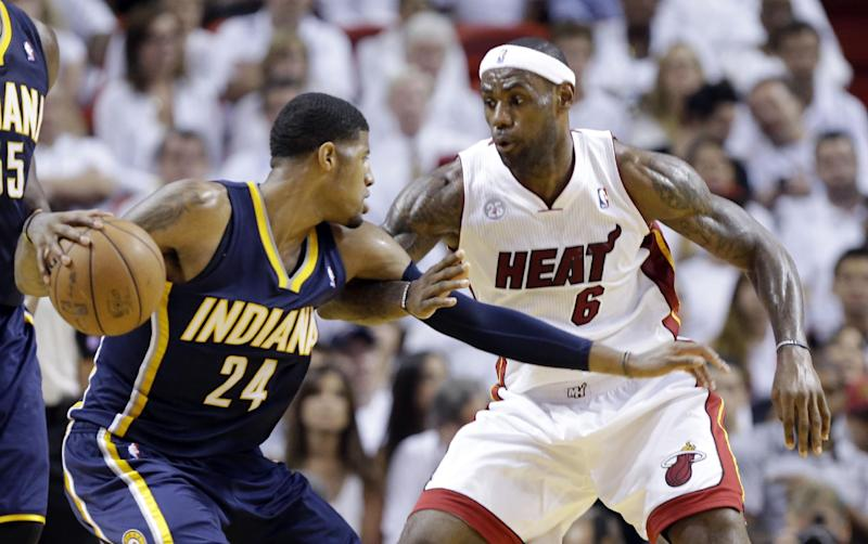 Miami Heat forward LeBron James (6) defends Indiana Pacers forward Paul George (24) during the second half of Game 5 in the NBA basketball playoffs Eastern Conference finals, Thursday, May 30, 2013, in Miami. (AP Photo/Lynne Sladky)