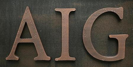 Raindrops are seen on AIG logo at AIG Building in Tokyo