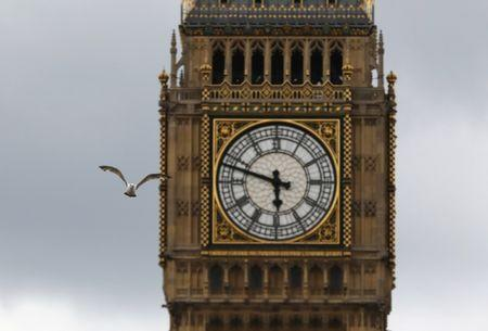 A bird flies past the Big Ben clock tower, above the Houses of Parliament in central, London, Britain, June 24, 2017. REUTERS/Marko Djurica