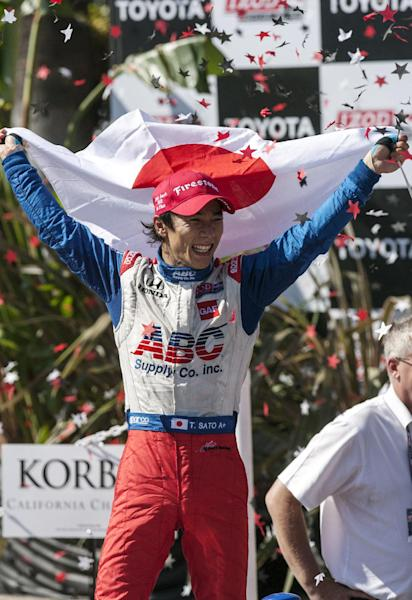 Takuma Sato, of Japan, celebrates his victory in the IndyCar Series Grand Prix of Long Beach auto race, Sunday, April 21, 2013, in Long Beach, Calif. Sato became the first Japanese driver to win an IndyCar race. (AP Photo/Ringo H.W. Chiu)