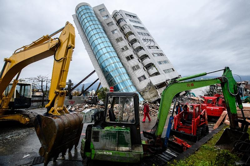 The Yun Tsui building, where six people died in the quake, is leaning at a precarious angle (AFP Photo/Anthony WALLACE)