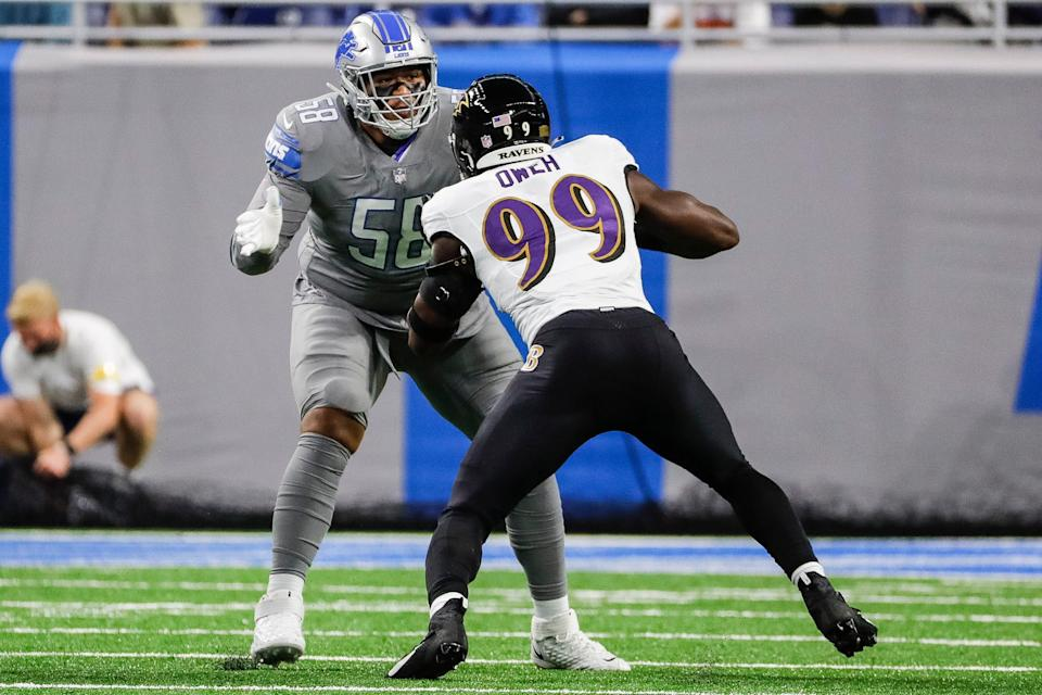 Detroit Lions offensive tackle Penei Sewell blocks Baltimore Ravens linebacker Odafe Oweh during the first half at Ford Field in Detroit on Sunday, Sept. 26, 2021.