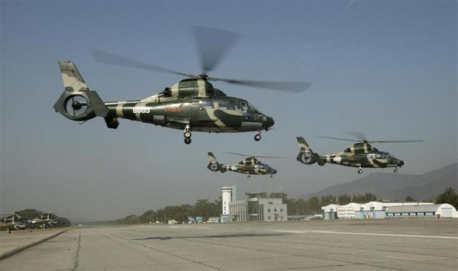 Chinese People's Liberation Army air force helicopters prepare to leave Hong Kong during the annual rotation of military personnel in Hong Kong November 25, 2008.