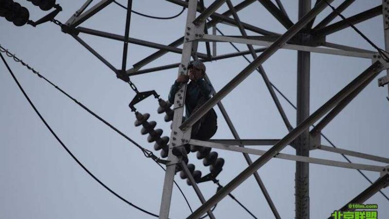 Chinese man stages three-day protest up electricity pylon
