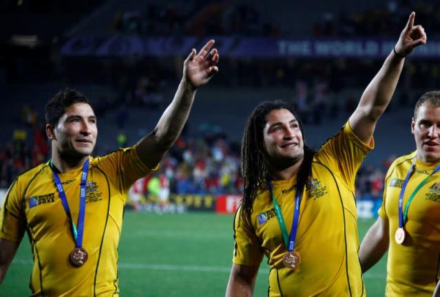 FILE PHOTO: Australia Wallabies' Anthony Faingaa and Saia Faingaa acknowledge supporters after their Rugby World Cup third place play-off match against Wales at Eden Park in Auckland