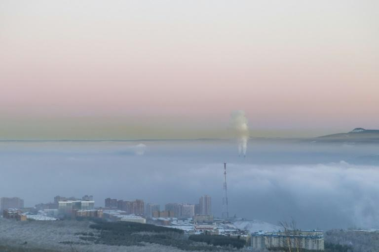 An aerial picture taken January 4, 2018 shows smog over Russia's industrial city of Krasnoyarsk where citizens are monitoring air quality for themselves