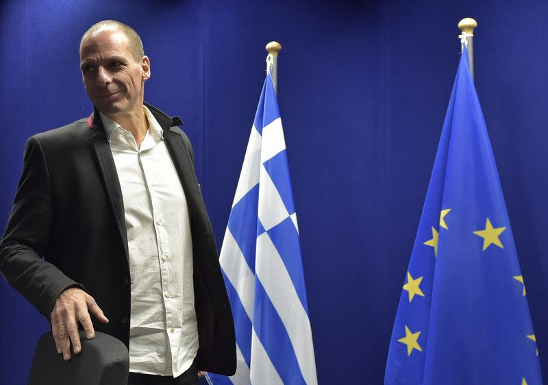 Varoufakis arrives at a news conference after an extraordinary euro zone Finance Ministers meeting in Brussels