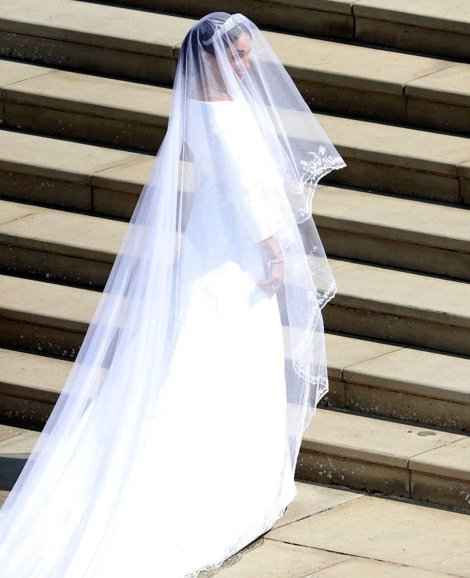 """<p>The white, boat-neck gown was designed by British designer Clare Waight Keller, the artistic director of French fashion house Givenchy. Meghan chose Clare because of her """"timeless and elegant aesthetic, impeccable tailoring, and relaxed demeanour"""", Kensington Palace said. (PA) </p>"""